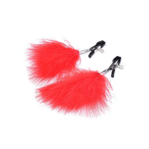Piros tollakkal díszített mellbimbó szorító csipesz